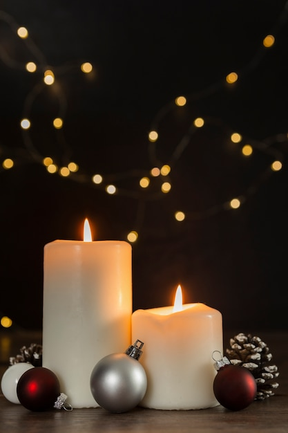 Christmas concept with candles and globes Free Photo