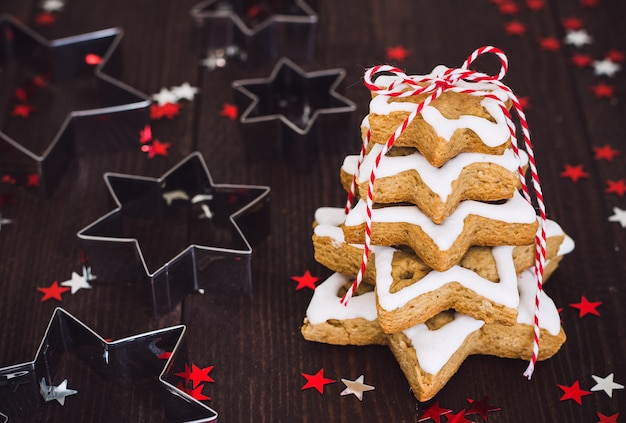Christmas cookie tree made with star cookie cutter gingerbread new year pasrty Free Photo