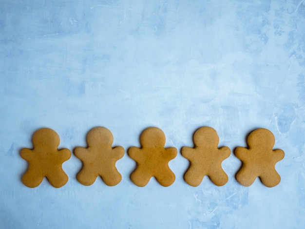 Christmas cookies isolated on light blue background. Premium Photo