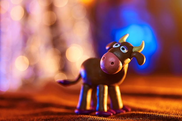 Christmas cow from plasticine Premium Photo
