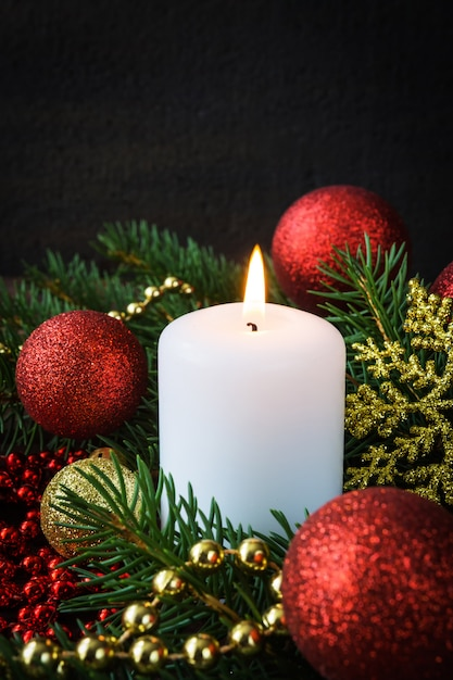 Christmas decor candles in the new year's composition festive decoration Premium Photo