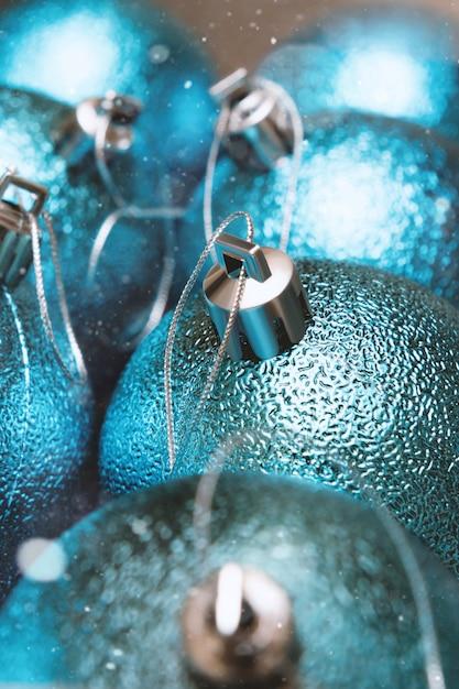 Christmas decoration close up. christmas balls in blue color. Premium Photo