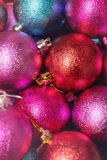 Christmas decoration close up. christmas red, pink and blue balls. Premium Photo