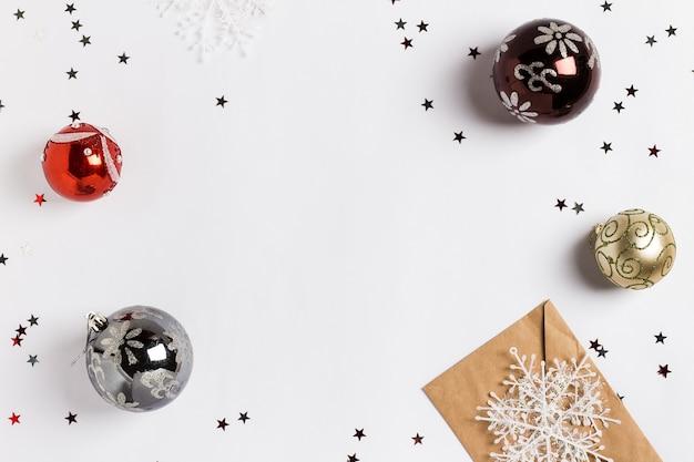 Christmas decoration composition greeting card envelope snowfalls balls glitter stars Free Photo