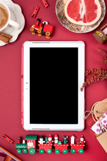 Christmas decoration and gift. morning fragrant coffee and rose petals. top view. different subjects on a red background. copy space, flat lay, Premium Photo
