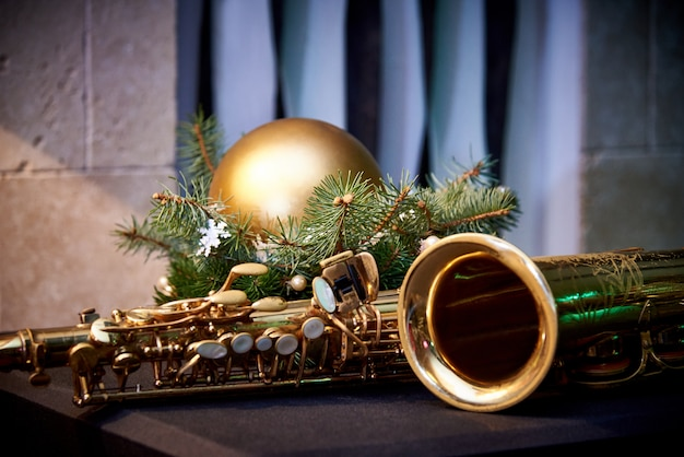 Christmas decoration and golden saxophone on wall Premium Photo