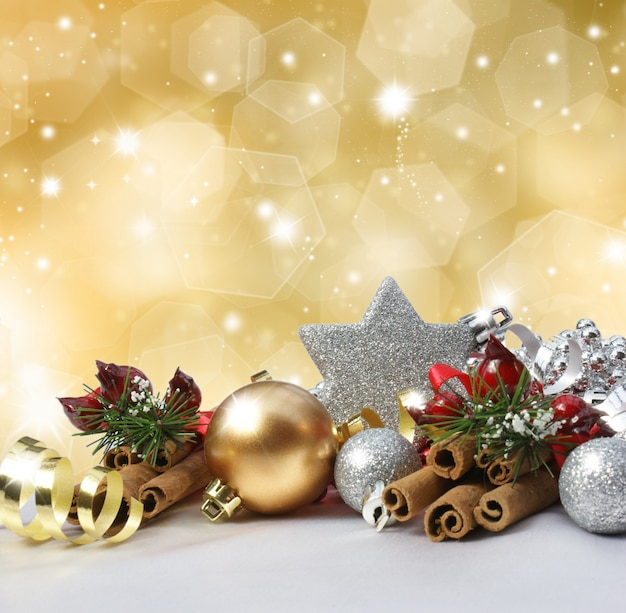 Christmas Decoration On A Glittery Gold Background Photo