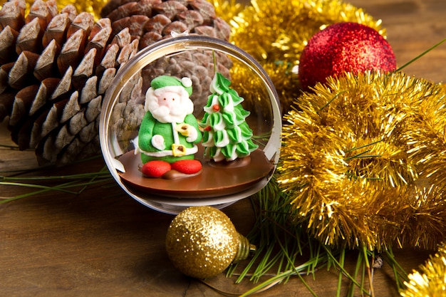 Christmas decoration and santa claus chocolate on wooden table Premium Photo
