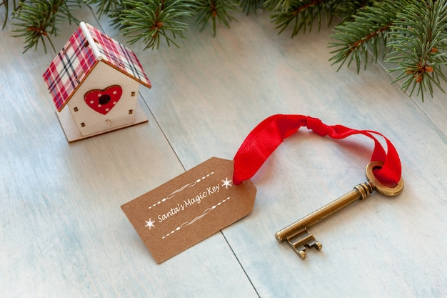 Christmas decoration - santa's magic key. close-up on light blue wooden background Premium Photo