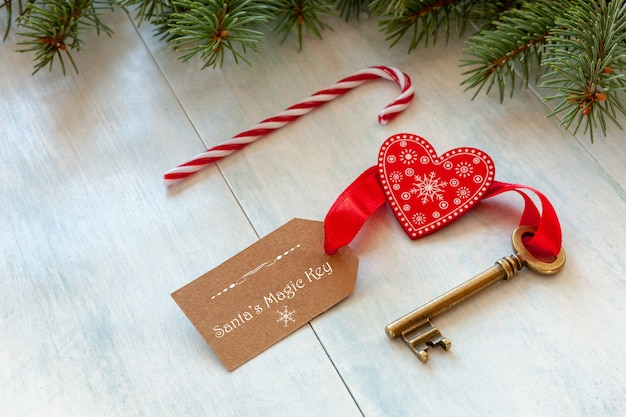 Christmas decoration - santa's magic key. close-up on light blue wooden background Premium Photo