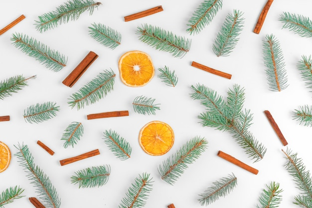 Christmas decoration with fir tree, dry oranges and cones Premium Photo