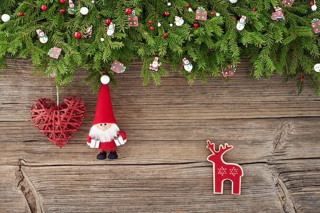 Christmas decoration with santa and heart on white wooden background. copy space, top view Premium Photo