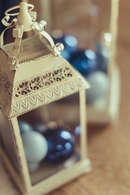 Christmas decoration with white candle lantern Premium Photo