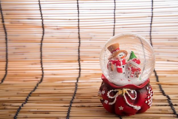 Christmas decoration on wood map background Premium Photo