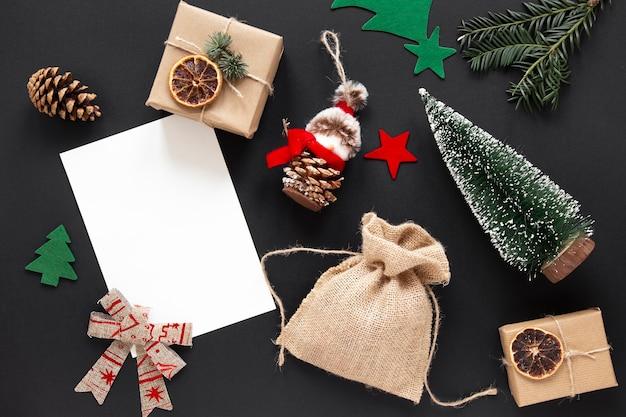 Christmas decorations on black background Free Photo