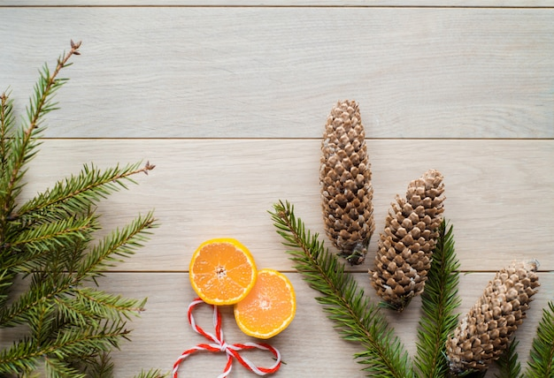 Christmas decorations from fir-tree branches and the fruits of mandarin orange Premium Photo