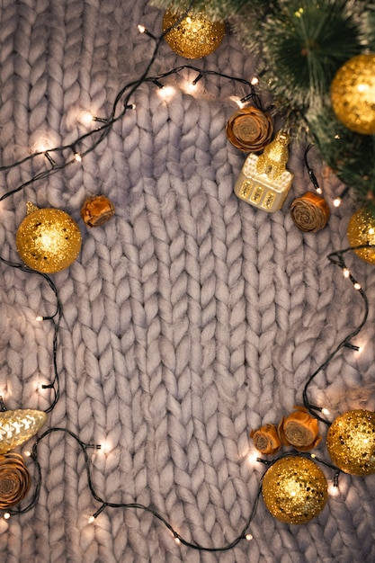 Christmas decorations on a gray knitted background with copyspace, flat lay Premium Photo