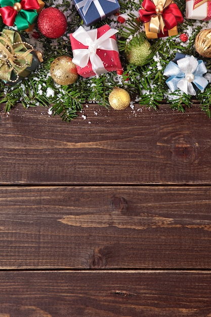 Christmas decorations on wooden background photo free for Background decoration images