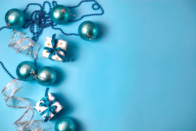 Christmas decorations with gift boxes, beads and balls Premium Photo
