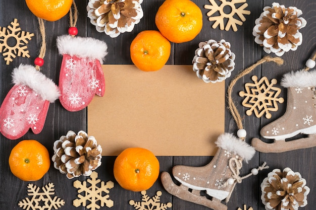 Christmas decorations - wooden deer, gloves, skates, snowflakes, cones, tangerines Premium Photo