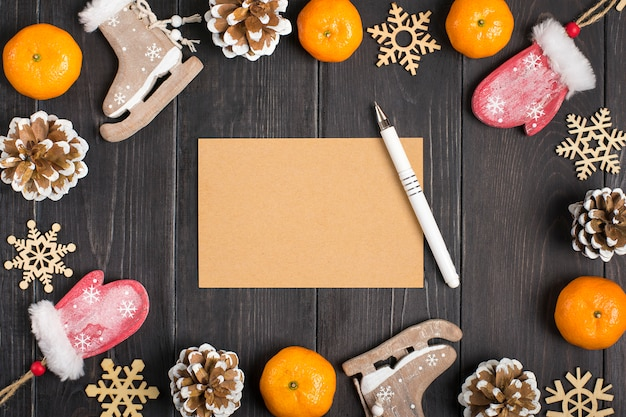 Christmas decorations - wooden deer, gloves, skates, snowflakes, cones, tangerines Premium Photo