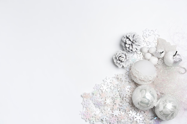 Christmas decorative composition of toys on a white table background. Free Photo