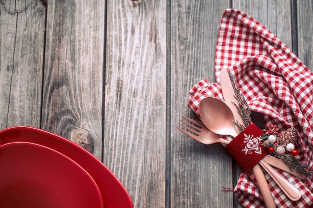 Christmas dinner cutlery with decor on a wooden background Free Photo