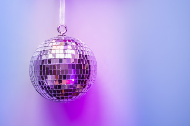 Christmas Disco Ball.Christmas Disco Ball On Neon Pink And Blue Photo Premium