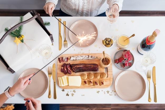Christmas family dinner table concept. christmas feast Premium Photo