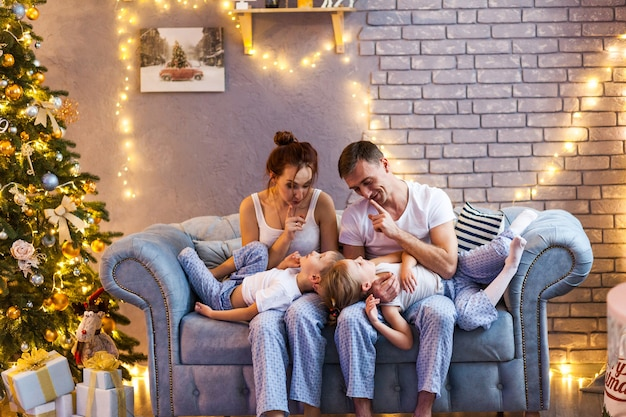 Christmas family with two kids in beautiful living room Premium Photo