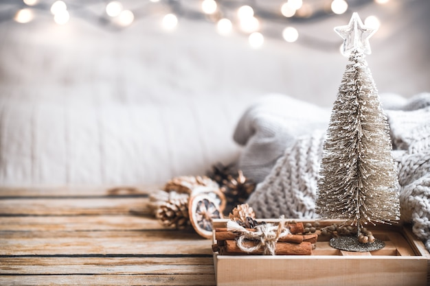 Christmas festive decor still life on wooden background, concept of home comfort and holiday Free Photo