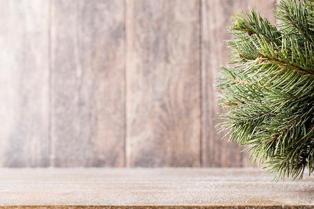 Christmas fir branch on table Premium Photo