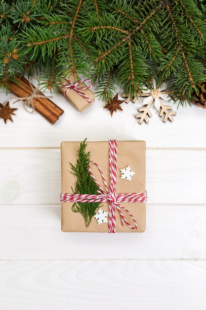 Christmas fir tree and gift box on wooden table. top view Premium Photo