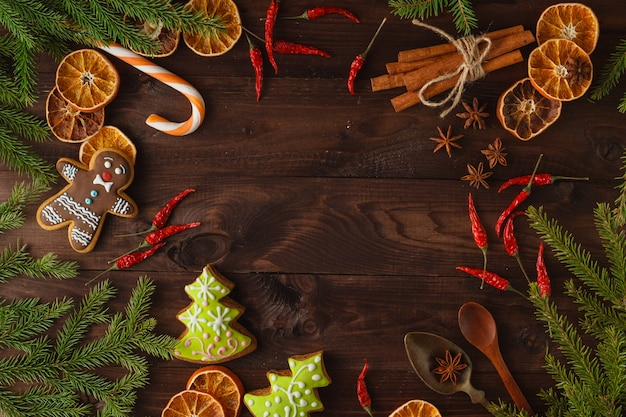 Christmas fir tree with decoration on dark wooden board in vintage style Premium Photo