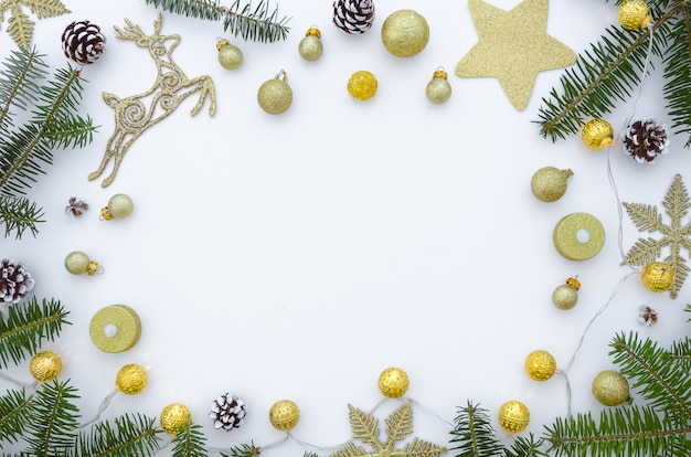 Christmas frame made of fir branches and decorations. christmas background. Premium Photo