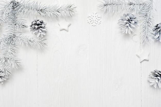 Christmas frame white tree branches border on wooden background Premium Photo