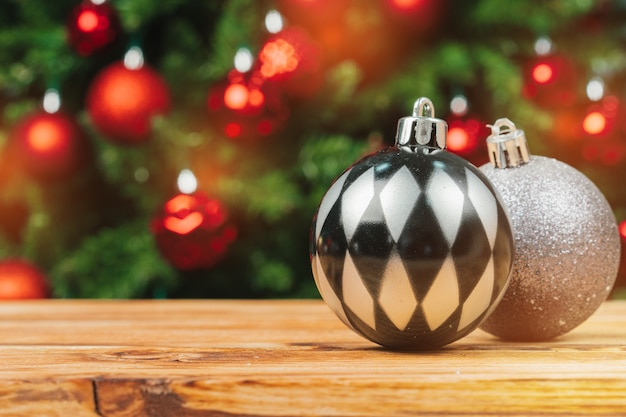 Christmas fur-tree decorations on wooden table close up Premium Photo