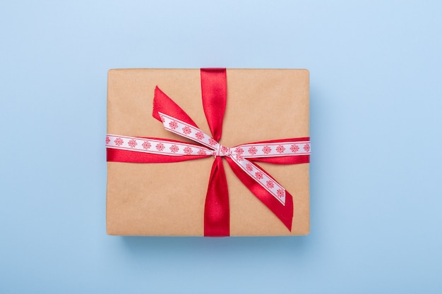 Christmas gift box on blue background Premium Photo