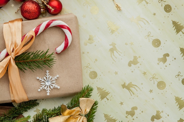 Christmas gift box, food decor and fir tree branch on wooden table. top view with copyspace Premium Photo
