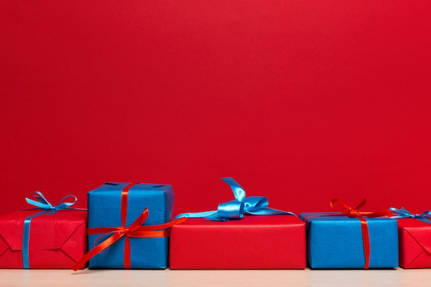 Christmas gift box on tablet, background with copyspace Premium Photo