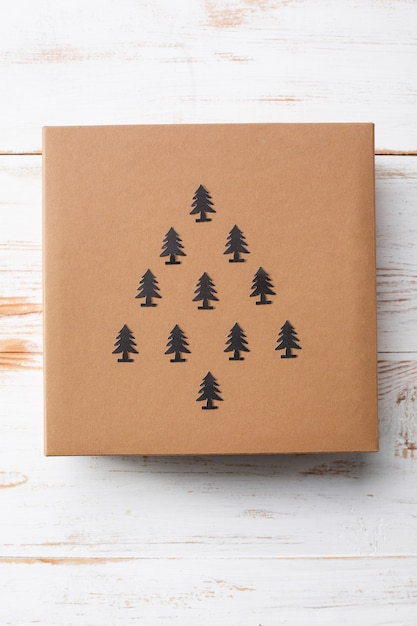 Christmas gift box over wooden surface. above. Free Photo