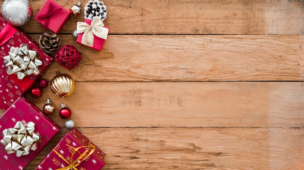 Christmas gift boxes with shiny baubles Free Photo