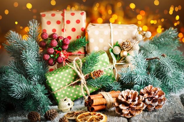 Christmas gift and christmas tree on dark wooden background Premium Photo