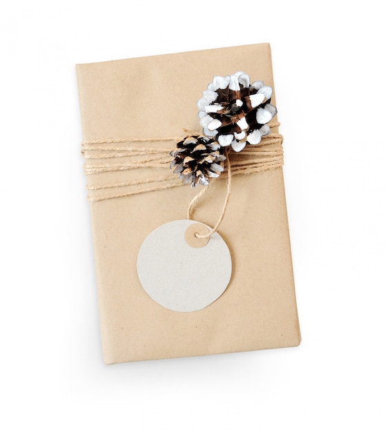 Christmas gift mockup box wrapped in brown recycled paper and cone rope top view Premium Photo