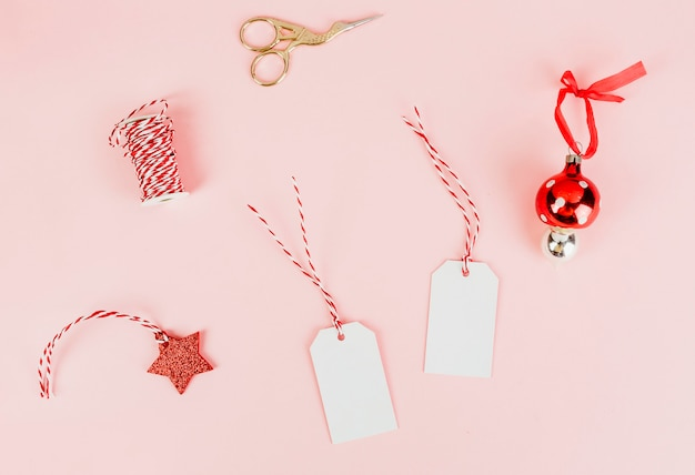 Christmas gift tags and a bauble Free Photo