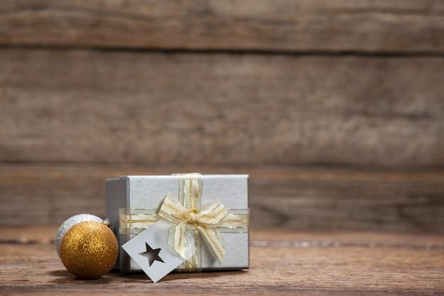 Christmas gift with colorful christmas balls Free Photo