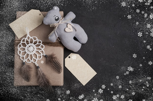Christmas gifts on concrete background with copyspace Premium Photo