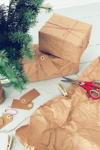 Christmas gifts, paper tags and christmas tree Free Photo