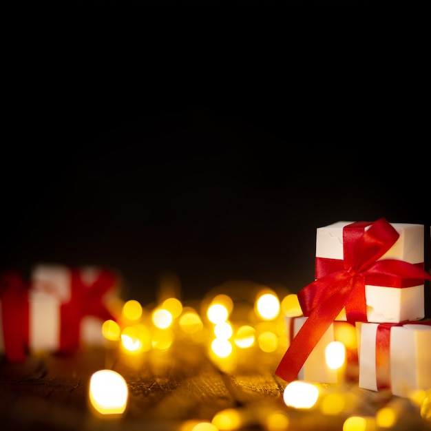 Christmas gifts with bokeh lights Free Photo