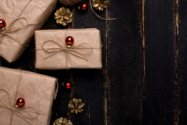 Christmas gifts with new year decoration on a wooden surface Premium Photo
